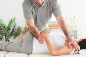 chiropractor fixing the spine of a woman
